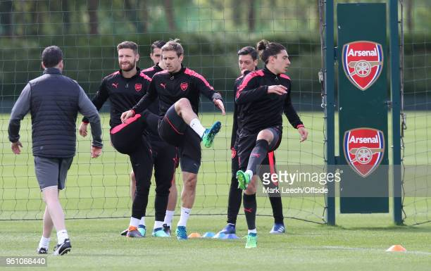 Shkodran Mustafi Nacho Monreal and Hector Bellerin warming up during Arsenal Training at London Colney on April 25 2018 in St Albans England