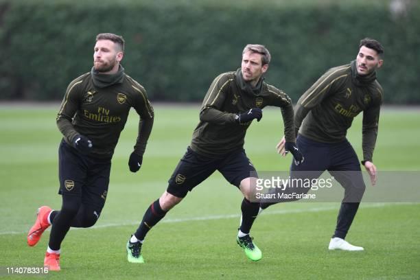Shkodran Mustafi Nacho Monreal and Sead Kolasinac of Arsenal during a training session at London Colney on April 06 2019 in St Albans England