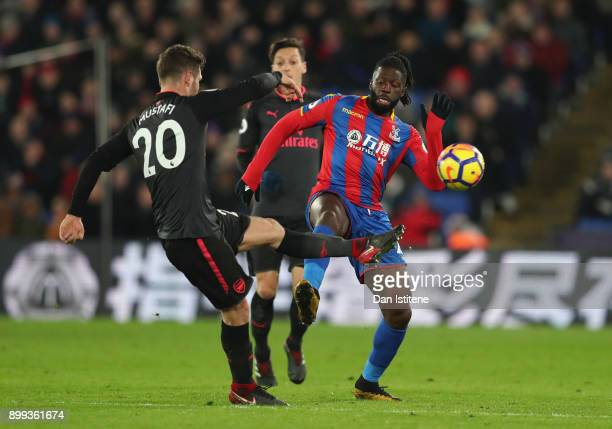 Shkodran Mustafi of Arsenal and Bakary Sako of Crystal Palace battle for the ball during the Premier League match between Crystal Palace and Arsenal...