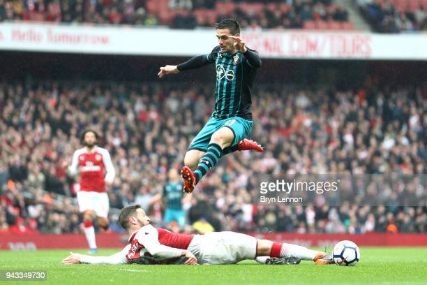 Shkodran Mustafi of Arsenal and Dusan Tadic of Southampton in action during the Premier League match between Arsenal and Southampton at Emirates...