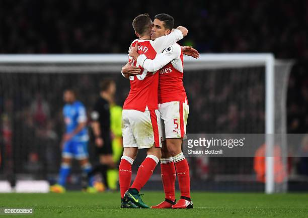 Shkodran Mustafi of Arsenal and Gabriel of Arsenal celebrates their sides third goal during the Premier League match between Arsenal and AFC...