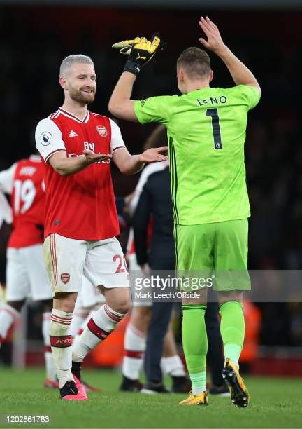 Shkodran Mustafi of Arsenal and goalkeeper Bernd Leno celebrate victory after the Premier League match between Arsenal FC and Everton FC at Emirates...