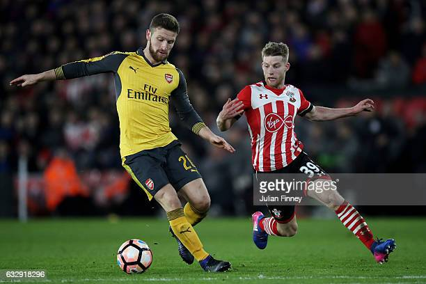 Shkodran Mustafi of Arsenal and Josh Sims of Southampton during the Emirates FA Cup Fourth Round match between Southampton and Arsenal at St Mary's...