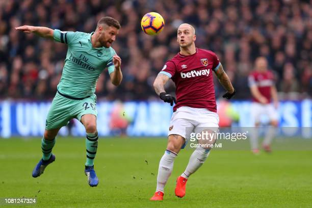 Shkodran Mustafi of Arsenal and Marko Arnautovic of West Ham United in action during the Premier League match between West Ham United and Arsenal FC...
