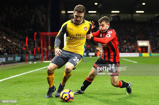 Shkodran Mustafi of Arsenal and Ryan Fraser of AFC Bournemouth compete for the ball during the Premier League match between AFC Bournemouth and...