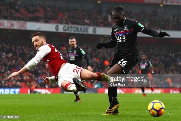 Shkodran Mustafi of Arsenal attempts to tackle Bakary Sako of Crystal Palace during the Premier League match between Arsenal and Crystal Palace at...