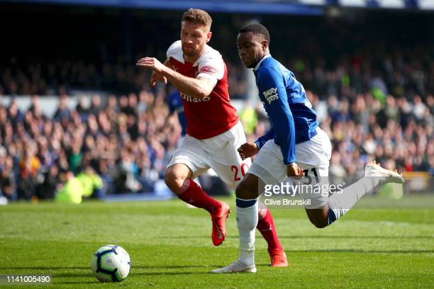 Shkodran Mustafi of Arsenal battles for possession with Ademola Lookman of Everton during the Premier League match between Everton FC and Arsenal FC...
