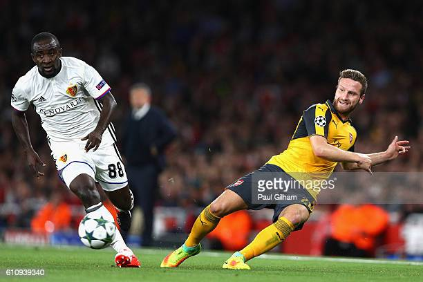 Shkodran Mustafi of Arsenal battles for the ball with Seydou Doumbia of Basel during the UEFA Champions League group A match between Arsenal FC and...