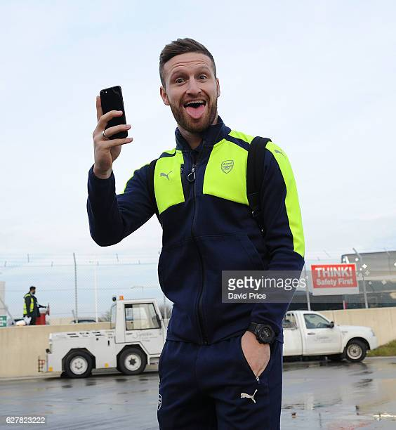 Shkodran Mustafi of Arsenal boards the plane at Luton Airport on December 5 2016 in Luton England