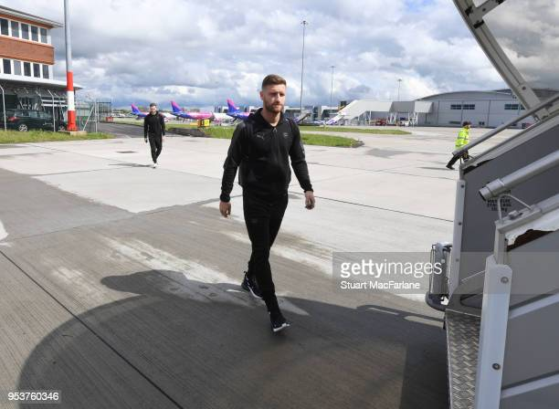 Shkodran Mustafi of Arsenal boards the team flight to Madrid at Luton Airport on May 2 2018 in Luton England