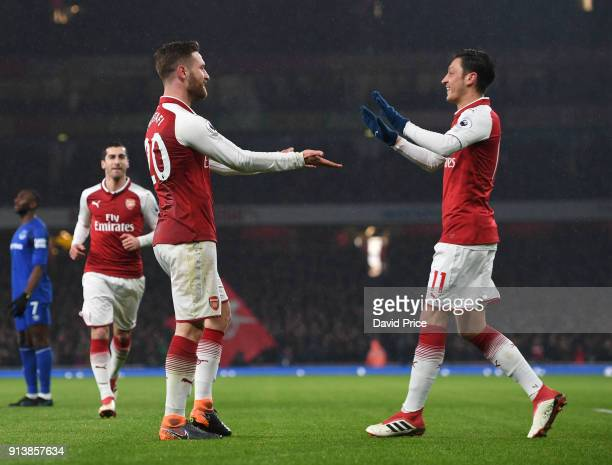 Shkodran Mustafi of Arsenal celebrates Arsenal's 2nd goal with Mesut Ozil during the match the Premier League match between Arsenal and Everton at...