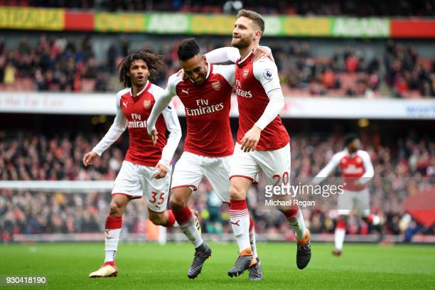 Shkodran Mustafi of Arsenal celebrates coring the first goal with PierreEmerick Aubameyang of Arsenal and Mohamed Elneny of Arsenal during the...