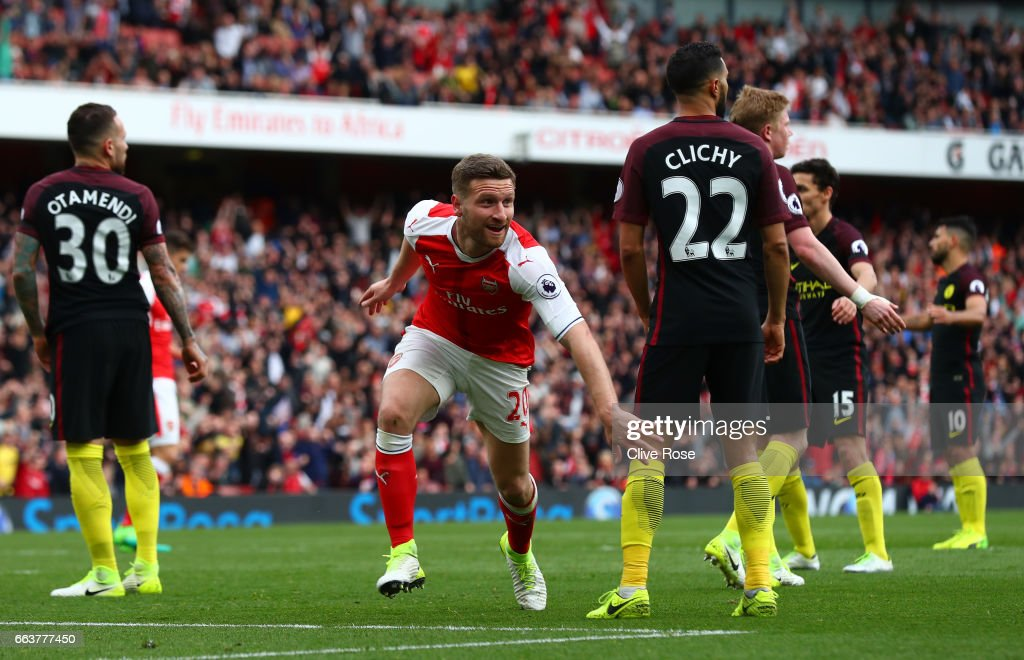 Shkodran Mustafi of Arsenal celebrates scoring his sides second goal during the Premier League match between Arsenal and Manchester City at Emirates Stadium on April 2, 2017 in London, England.