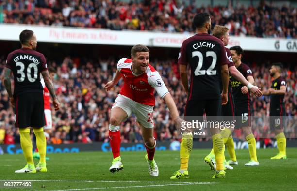 Shkodran Mustafi of Arsenal celebrates scoring his sides second goal during the Premier League match between Arsenal and Manchester City at Emirates...