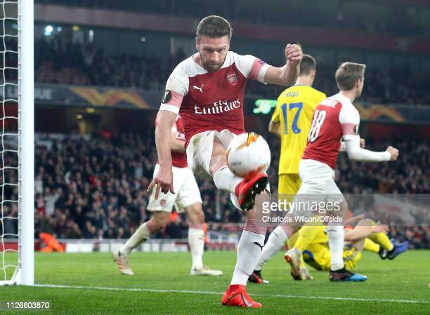 Shkodran Mustafi of Arsenal celebrates scoring their 2nd goal by kicking the ball into the air during the UEFA Europa League Round of 32 Second Leg...