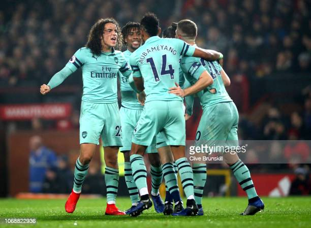 Shkodran Mustafi of Arsenal celebrates with team mates after scoring their team's first goal during the Premier League match between Manchester...