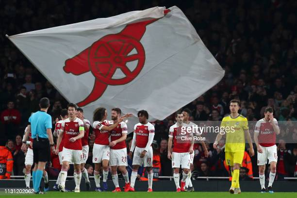 Shkodran Mustafi of Arsenal celebrates with teammates after scoring his team's second goal during the UEFA Europa League Round of 32 Second Leg match...
