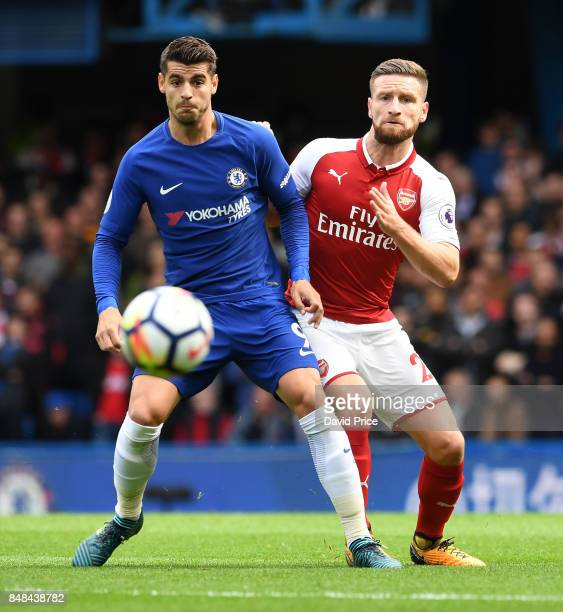 Shkodran Mustafi of Arsenal challenges Alvaro Morata of Chelsea during the Premier League match between Chelsea and Arsenal at Stamford Bridge on...