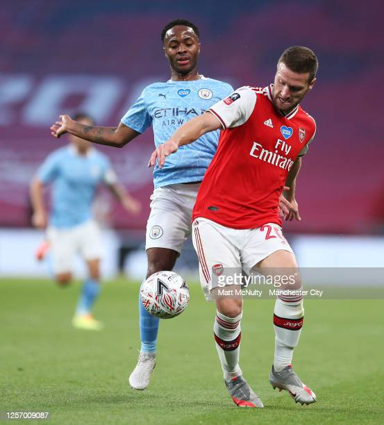 Shkodran Mustafi of Arsenal challenges Raheem Sterling of Manchester City during the FA Cup Semi Final match between Arsenal and Manchester City at...