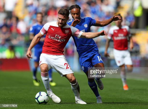 Shkodran Mustafi of Arsenal clears from Bobby Reid of Cardiff City during the Premier League match between Cardiff City and Arsenal FC at Cardiff...