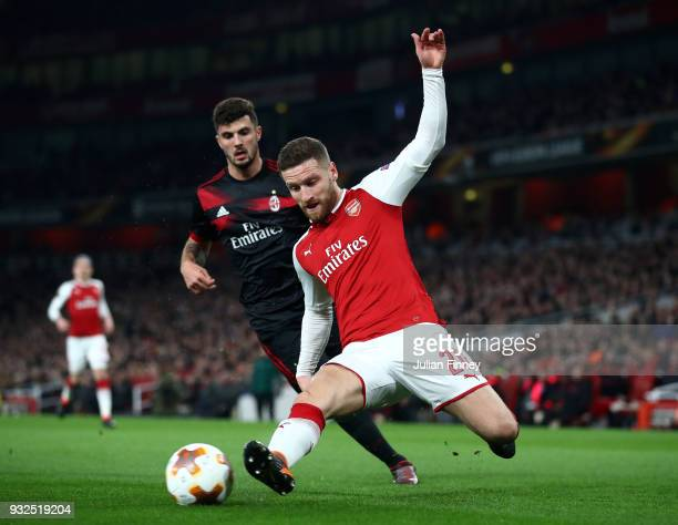 Shkodran Mustafi of Arsenal clears the ball from Patrick Cutrone of AC Milan during the UEFA Europa League Round of 16 Second Leg match between...