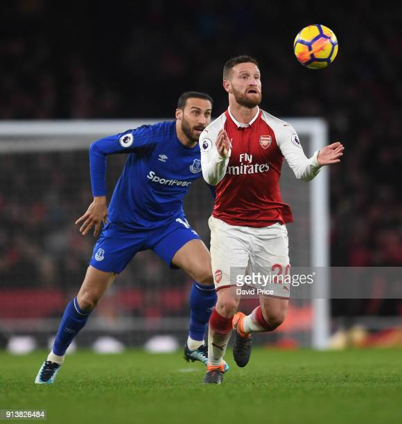 Shkodran Mustafi of Arsenal controls the ball under pressure from Cenk Tosun of Everton during the match the Premier League match between Arsenal and...