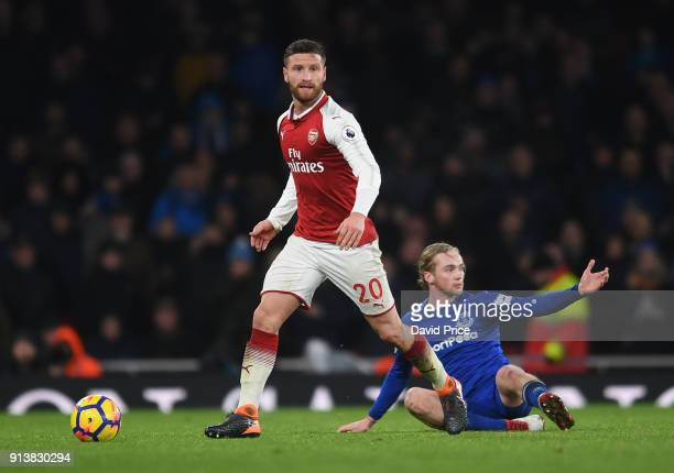 Shkodran Mustafi of Arsenal drives away from Tom Davies of Everton during the match the Premier League match between Arsenal and Everton at Emirates...