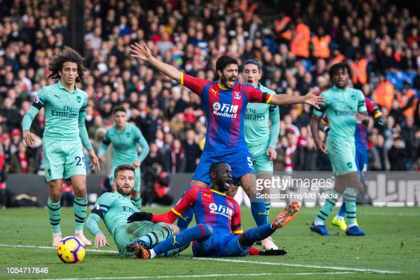 Shkodran Mustafi of Arsenal fouls Cheikhou Kouyaté of Crystal Palace giving the 1st penalty for home side during the Premier League match between...