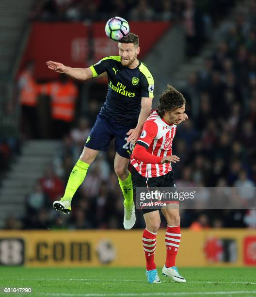 Shkodran Mustafi of Arsenal heads the ball under pressure from Manolo Gabbiadini of Southampton during the Premier League match between Southampton...