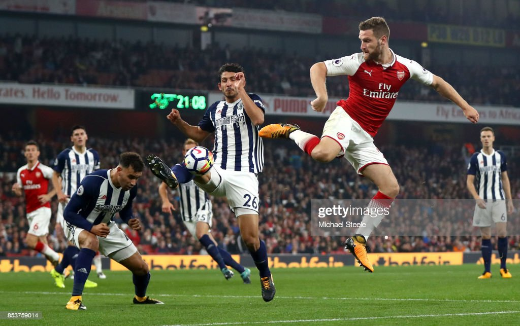 Shkodran Mustafi of Arsenal is blocked by Hal Robson-Kanu and Ahmed El-Sayed Hegazi of West Bromwich Albion during the Premier League match between Arsenal and West Bromwich Albion at Emirates Stadium on September 25, 2017 in London, England.