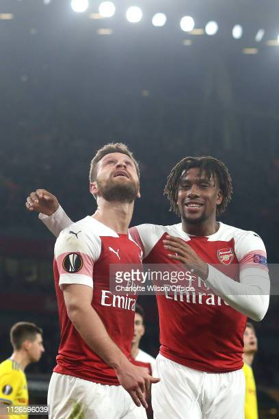 Shkodran Mustafi of Arsenal looks up for the ball as he celebrates scoring their 2nd goal with Alex Iwobi during the UEFA Europa League Round of 32...