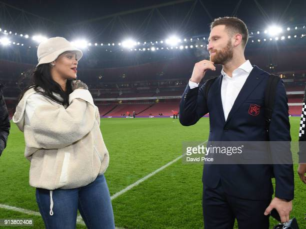 Shkodran Mustafi of Arsenal meets pop star Rihanna after the Premier League match between Arsenal and Everton at Emirates Stadium on February 3 2018...