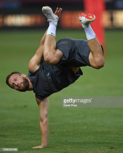Shkodran Mustafi of Arsenal messes around during the Arsenal Training Session at Singapore American School on July 27 2018 in Singapore