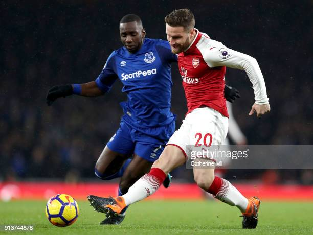 Shkodran Mustafi of Arsenal passes under pressure from Yannick Bolasie of Everton during the Premier League match between Arsenal and Everton at...