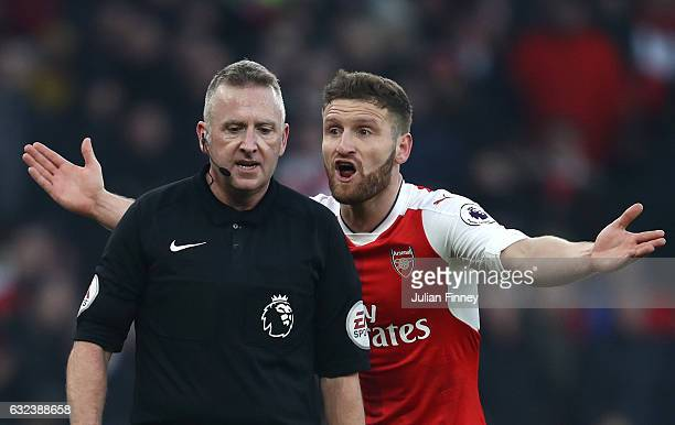 Shkodran Mustafi of Arsenal protests referee Jonathan Moss over the penalty decision during the Premier League match between Arsenal and Burnley at...