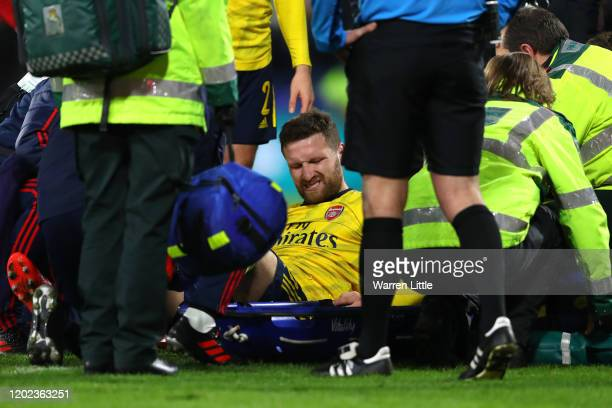 Shkodran Mustafi of Arsenal reacts as he receives medical treatment during the FA Cup Fourth Round match between AFC Bournemouth and Arsenal at...