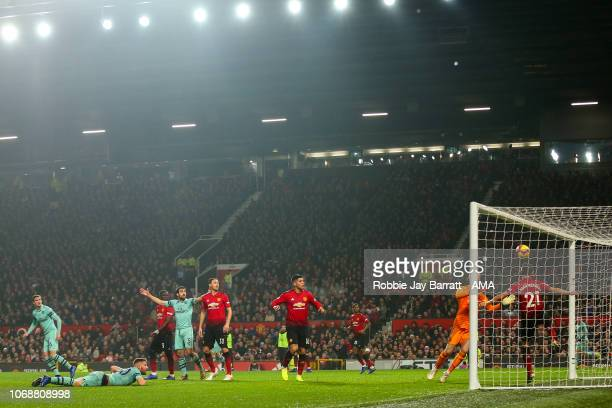 Shkodran Mustafi of Arsenal scores a goal to make it 01 during the Premier League match between Manchester United and Arsenal FC at Old Trafford on...