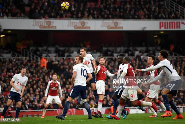 Shkodran Mustafi of Arsenal scores his sides first goal during the Premier League match between Arsenal and Tottenham Hotspur at Emirates Stadium on...
