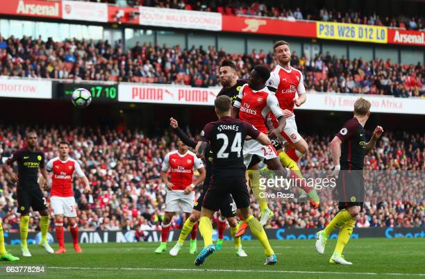 Shkodran Mustafi of Arsenal scores his sides second goal during the Premier League match between Arsenal and Manchester City at Emirates Stadium on...