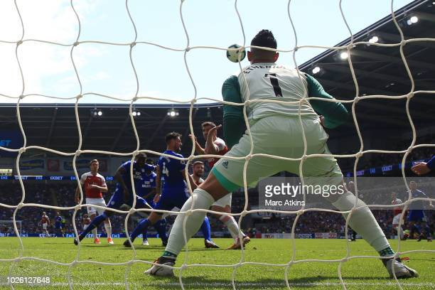 Shkodran Mustafi of Arsenal scores the reining goal during the Premier League match between Cardiff City and Arsenal FC at Cardiff City Stadium on...