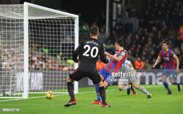 Shkodran Mustafi of Arsenal scores their first goal during the Premier League match between Crystal Palace and Arsenal at Selhurst Park on December...