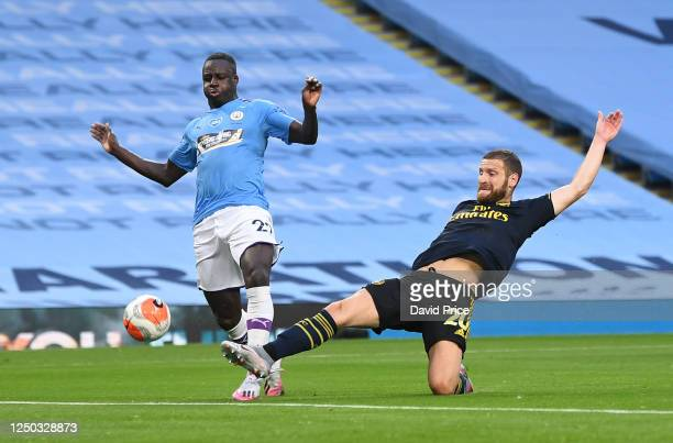 Shkodran Mustafi of Arsenal stretches for the ball under pressure from Benjamin Mendy of Man City during the Premier League match between Manchester...