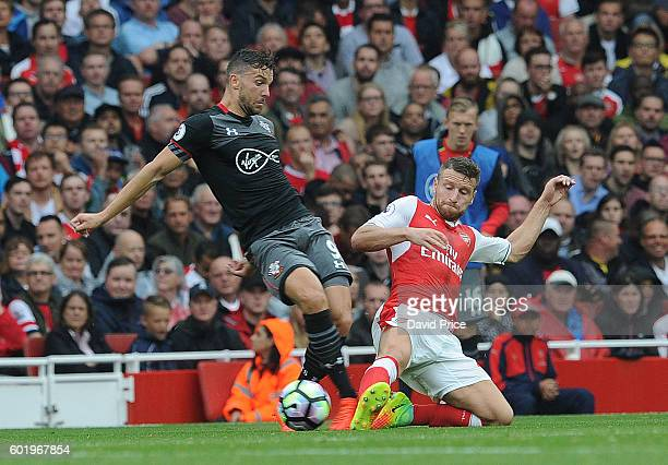 Shkodran Mustafi of Arsenal tackles JAy Rodriguez of Southampton during the Premier League match between Arsenal and Southampton at Emirates Stadium...