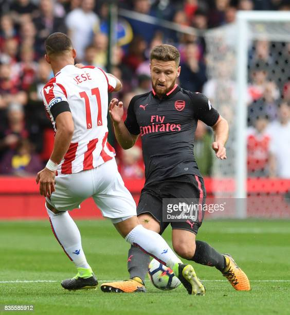Shkodran Mustafi of Arsenal tackles Jese of Stoke during the Premier League match between Stoke City and Arsenal at Bet365 Stadium on August 19 2017...