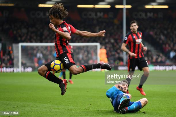 Shkodran Mustafi of Arsenal tackles Nathan Ake of AFC Bournemouth during the Premier League match between AFC Bournemouth and Arsenal at Vitality...
