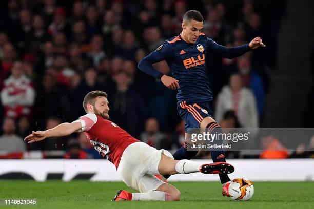 Shkodran Mustafi of Arsenal tackles Rodrigo Moreno of Valencia during the UEFA Europa League Semi Final First Leg match between Arsenal and Valencia...