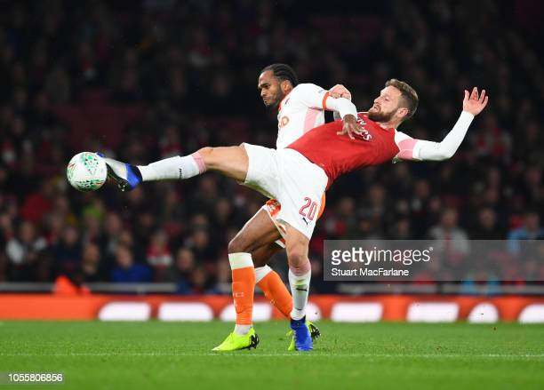 Shkodran Mustafi of Arsenal takes on Nathan Delfouneso of Blackpool during the Carabao Cup Fourth Round match between Arsenal and Blackpool at...