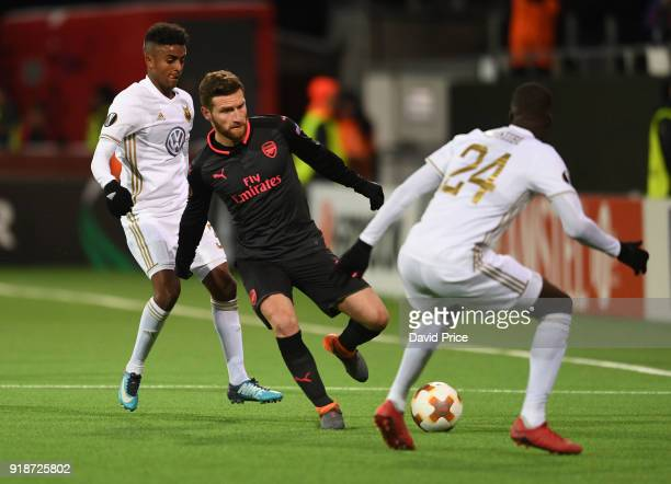 Shkodran Mustafi of Arsenal takes on Tesfaldet Tekie of Ostersunds during UEFA Europa League Round of 32 match between Ostersunds FK and Arsenal at...