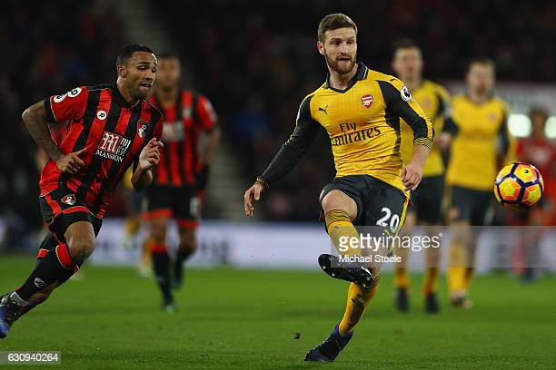 Shkodran Mustafi of Arsenal tracked by Callum Wilson of Bournemouth during the Premier League match between AFC Bournemouth and Arsenal at the...