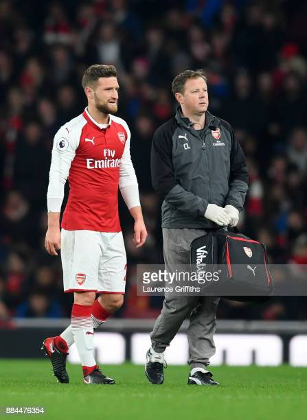 Shkodran Mustafi of Arsenal walks off injured during the Premier League match between Arsenal and Manchester United at Emirates Stadium on December 2...